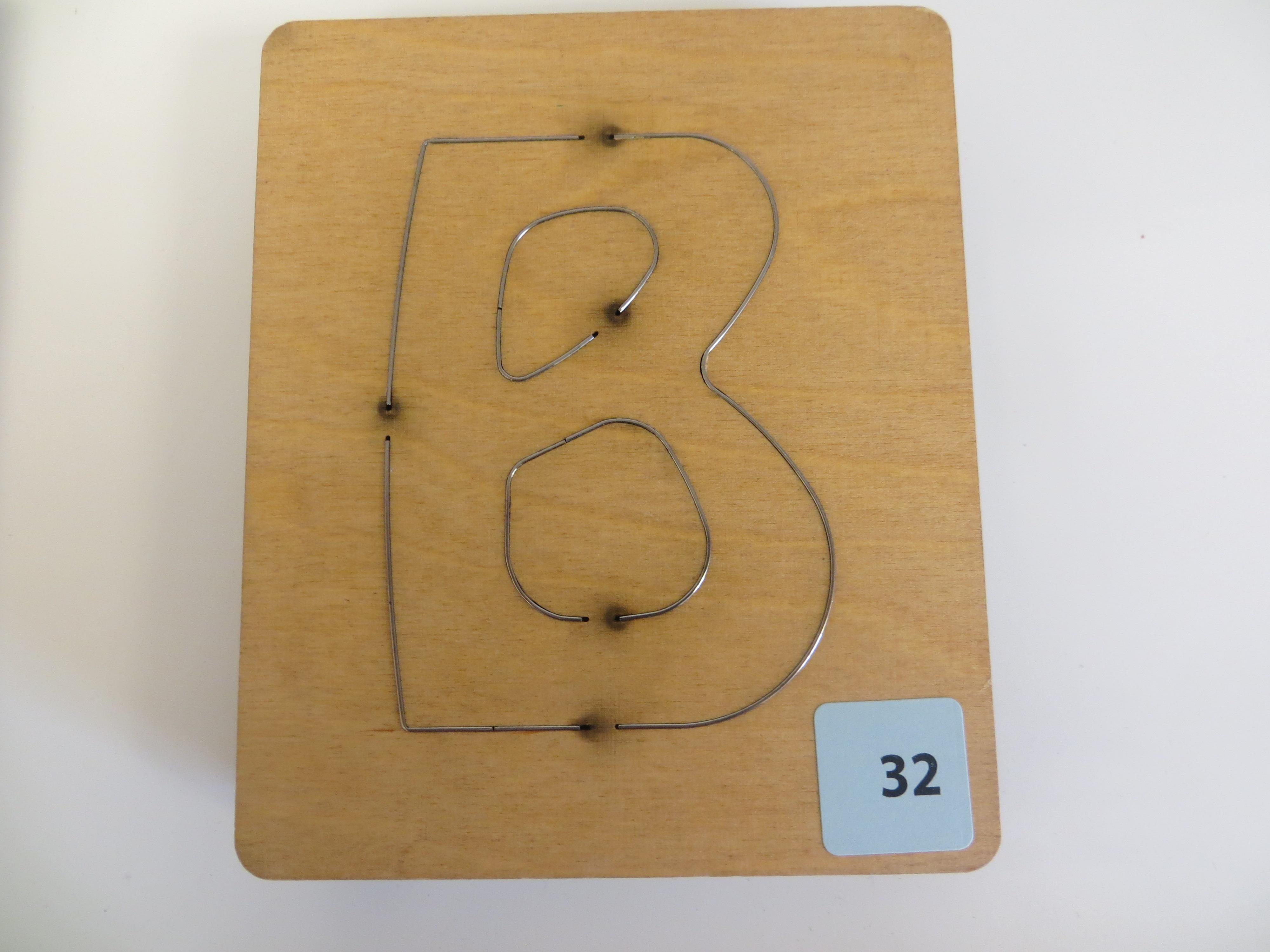 #32 B